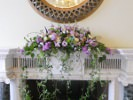 Mantelpiece arrangement with veronica, scented stock, roses - ocean song, amnesia and avalanche