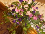 Top table flower arrangement in pinks and purples