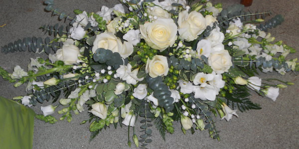 wedding white rose top table arrangement